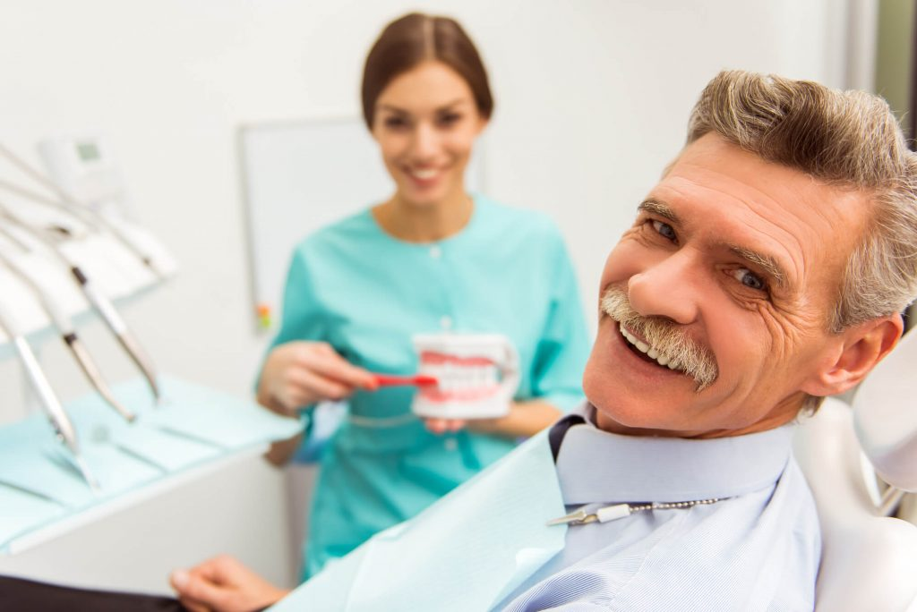 A dentist informing a patient about Dentures in Naples FL